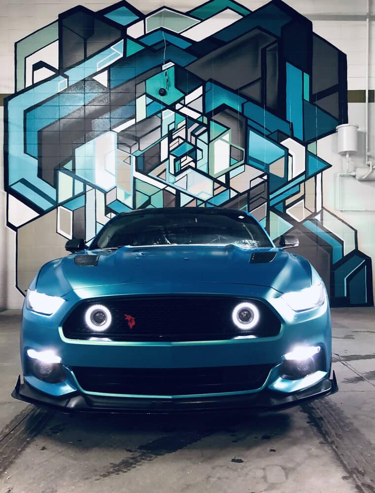 car in front of graffiti art at Arthur's Car Wash